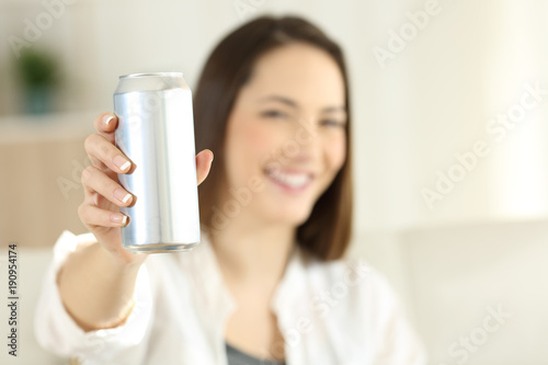 Woman showing a soda refreshment can