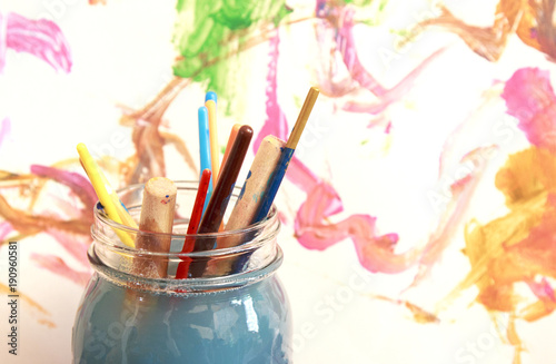 Fotografie, Obraz  Paint brushes soaking in a glass jar of soapy water