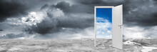 White Open Door With Blue Sky On Concrete Floor In Front Of Dark Cloudy Panorama Wide Background / Business Chance Motivation Concept / Tür Offen Konzept