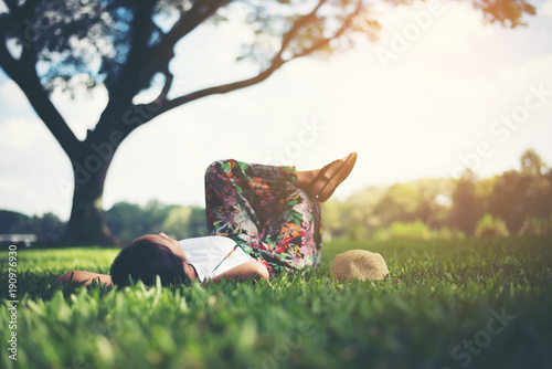 Fotografie, Obraz  Young woman lying down on grass. relax time.