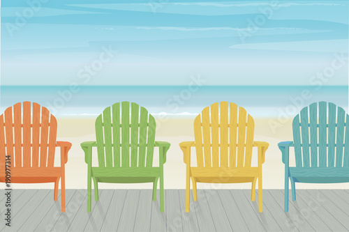 Four colorful wooden Adirondack chairs in a row on a wooden deck at the beach Canvas Print