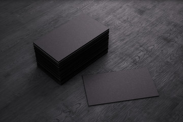 Blank template black Business Cards on black wooden background. 3D rendering.