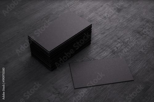 Fotografia  Blank template black Business Cards on black wooden background
