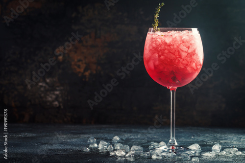 Red drink with ice