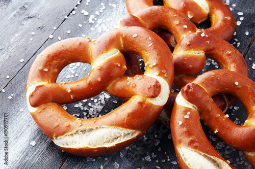 German pretzels with salt close-up on the table. Wallpaper Mural