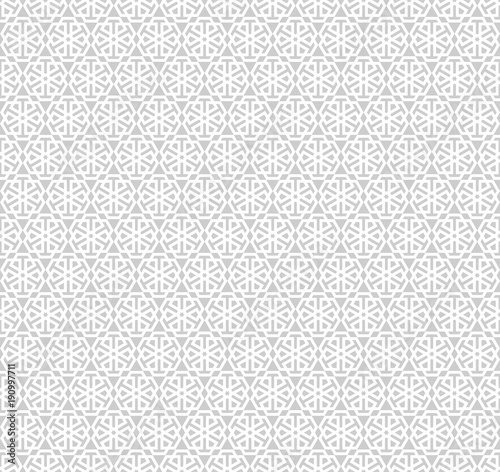 Abstract gray pattern geometric of Islamic, Arabesque ornament on white background. Seamless Vector illustration. © sirintra