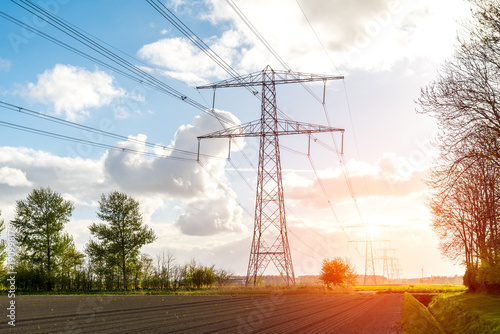sunset above the modern high powerlines Canvas Print