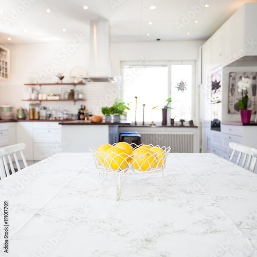 Pleasing Fresh Lemons In A Bowl On The Kitchen Table With The Kitchen Best Image Libraries Thycampuscom