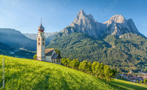 Fényképezés  Alpine scenery with church in the Dolomites, Seis am Schlern, South Tyrol, Italy