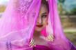 Leinwanddruck Bild - Beautiful Thai woman wearing traditional Thai dress with silk fabric cover her head