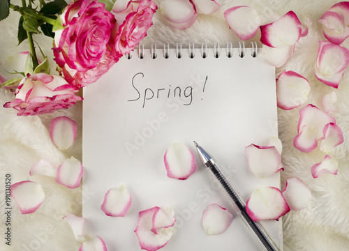 Garden Poster Narcissus Notepad with inscription spring rose petals on a white background