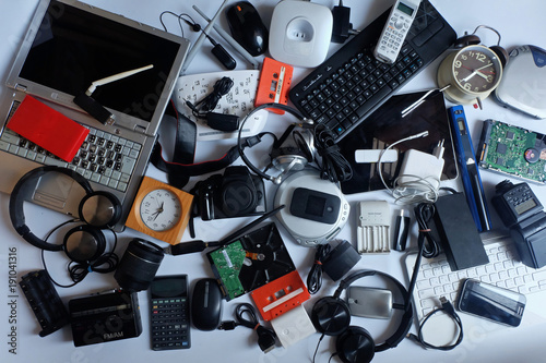 Fototapeta Pile of used Electronic Waste on white background, Reuse and Recycle concept, Top view  obraz na płótnie