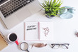 Laptop,coffee,spectacle,magnifying glass,green plant and notebook written with text CONTENT IS KING on white office desk table.Creative lay out view from top with copy space.