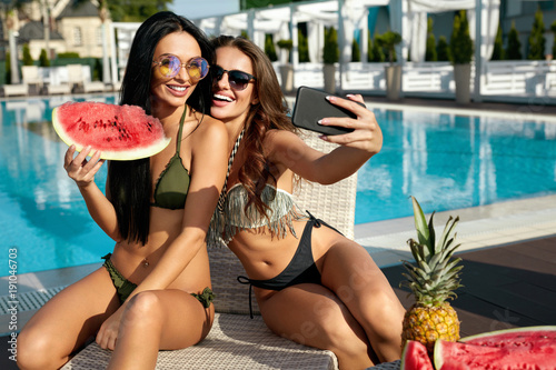 Fotografie, Obraz  Summer Fashion. Girls Having Fun Taking Photos Near Pool.