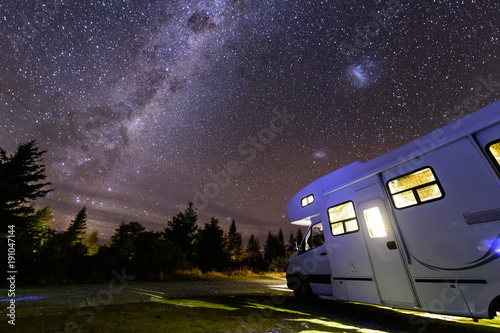 Photo  Motorhome under milky way