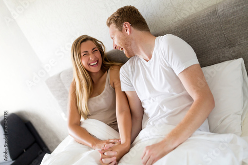 Fotografie, Obraz  Laughing and giggling couple in bed