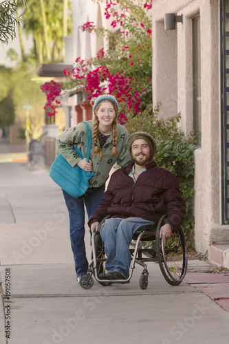 Photo  Young Woman and Man in Wheelchair on Sidewalk