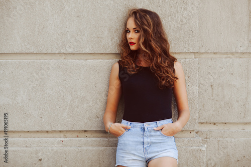 Fotografie, Obraz  Potrait of beautiful young woman with beautiful curly hair