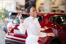 Beautiful Young Mixed Race Black African American Woman Driving Car And Show Holding The Key