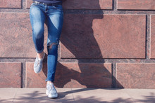 Girl In Jeans And Sneakers On ...