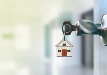 Open Door With Keys In Keyhole