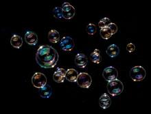 Rainbow Soap Bubbles On Black ...