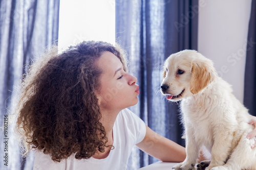 Teenager girl with a small golden retriever - Buy this stock photo
