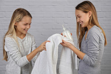 Portrait Of Two Teenage Girls Washing Hands With Soap. Hygiene Concept