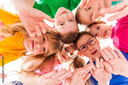 Fotografie, Obraz  Kids faces in a round