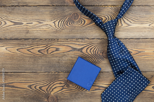 Fototapeta Happy father's day concept with tie and gift on a wooden background. Place under the text obraz