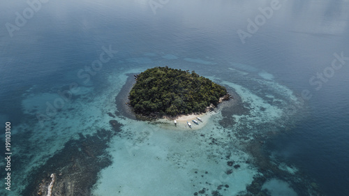 Aerial view of island surrounded by ocean