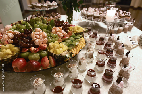 Wedding Various Fresh Fruits With Tasty Colour And Desserts In Cups