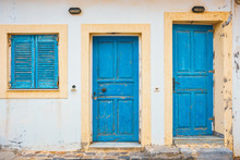 Blue Shutters And Doors On A White Wall, Close Up