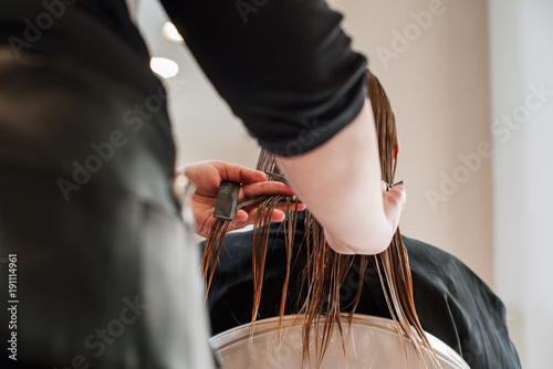 Spoed Foto op Canvas Kapsalon Stylist hairdresser doing haircut closeup of work equipment, the beauty industry