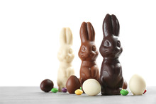 Chocolate Easter Bunnies And Candies On Table