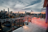 Fototapeta Nowy York - Luxury city rooftop balcony with chilling area in New York City Manhattan midtown. Elite real estate concept.