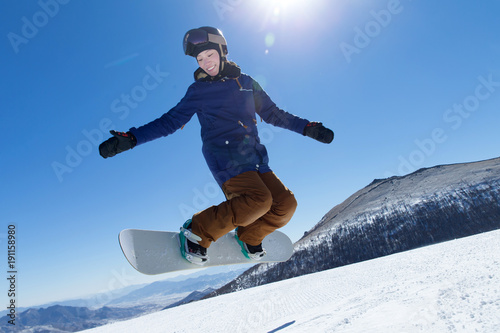Young woman skiing outdoors against mountain