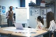 Executive giving presentation to coworker over flip chart