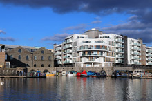 Harbourside Scene With Storm C...