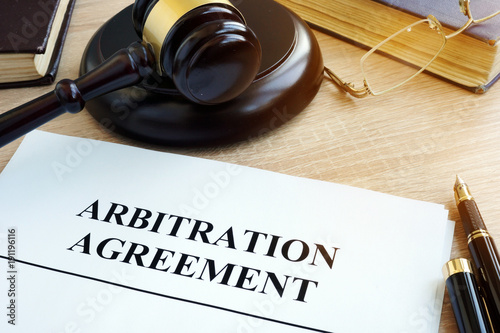 Photo Arbitration agreement resolution of commercial disputes on a desk