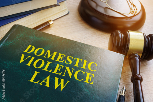 Fotografija Domestic violence law on a wooden table.