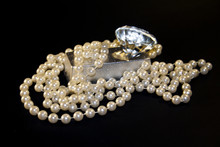 Diamond And Pearls Isolated On...
