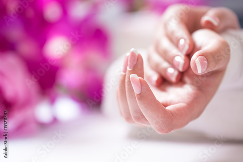 Staande foto Manicure Closeup shot of beautiful female dands with nails of france manicure. Manicure and spa concept