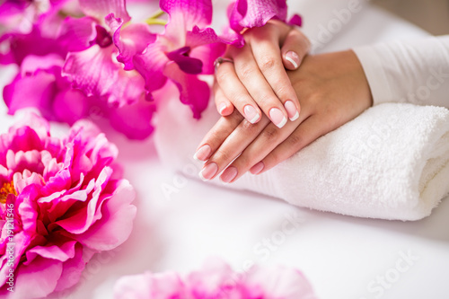 Foto op Canvas Manicure Closeup shot of beautiful female dands with nails of france manicure. Manicure and spa concept