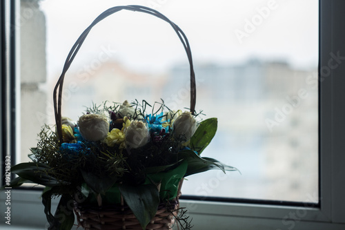 Photo  basket with flowers on the window