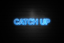 Catch Up Neon Sign On Brickwall