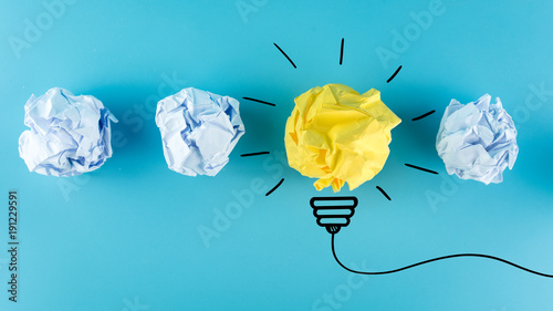 Fototapeta Creative idea, Inspiration, New idea and Innovation concept with Crumpled Paper light bulb on blue background. obraz