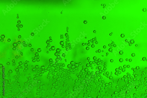 The green bubbles in soda water as a texture. - 191241739