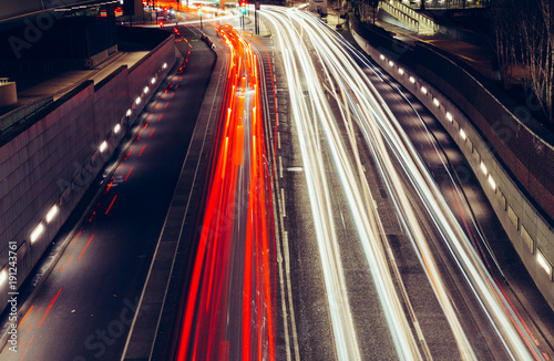 City light trails of fast moving traffic on road in London at night Canvas Print