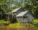 Old mill by stream